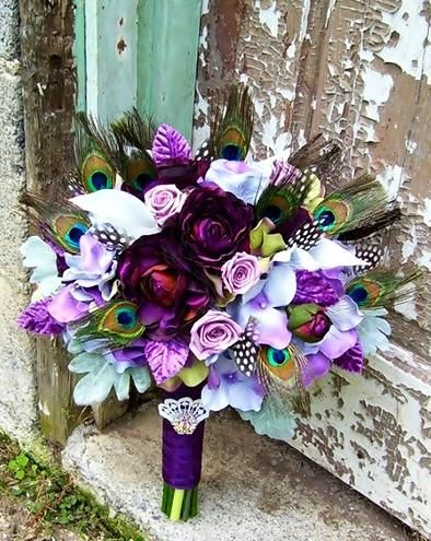 Bridal bouquet in purples. Peacock Feathers, Purple Roses, Dusty Miller