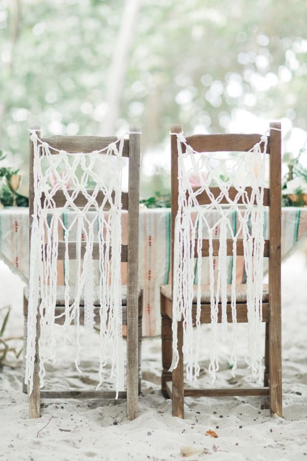 Bohemian style macrame hanging on chairs - love this look for a beach wedding reception!