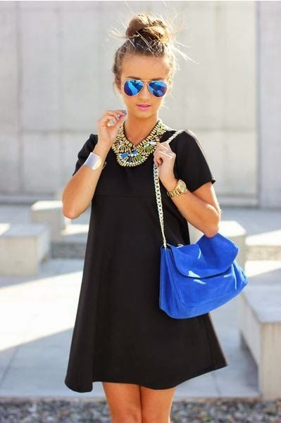 Black mini dress and blue handbag, plus some cute tights or leggings would be great
