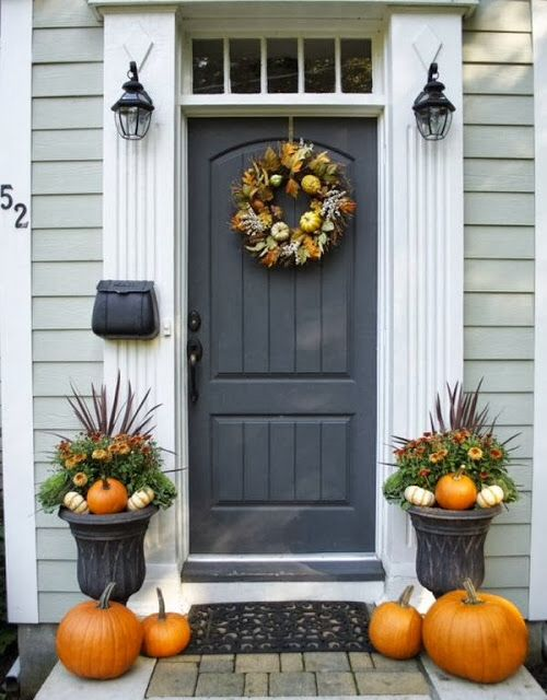 Front door with windows above and trim. Fall decorating..symmetric entrance with transom, pumpkins and planters..pretty!