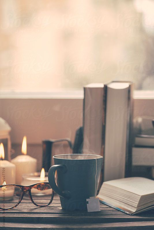 Still life of used books, tea, glasses and candles on a wood table.  by BONNINSTUDIO | Stocksy United