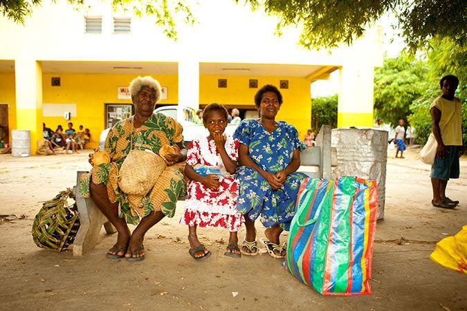 Grandma, mum and daughter wait for the next bus, Espiritu Santo.