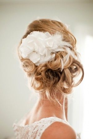 Bridal updo with hair flower with feathers | photography by www.megruth.com/