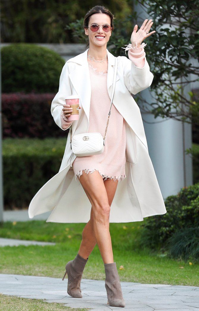 Alessandra Ambrosio in a pink sweater dress, white coat, Gucci bag and booties - click through to see more celebrity fall outfit ideas