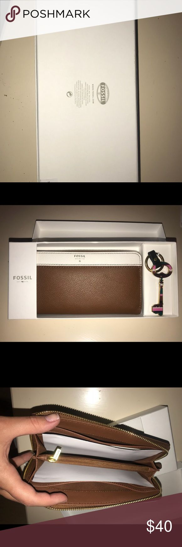 NWT Fossil Brown/Cream Clutch/Wallet plus Keychain Cute brown clutch that can be used as a clutch or wallet. An iPhone plus even fits in it! Comes with a cute keychain as well! Fossil Bags Clutches & Wristlets