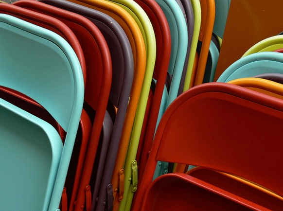 Love the colours of these outdoor chairs all stacked together