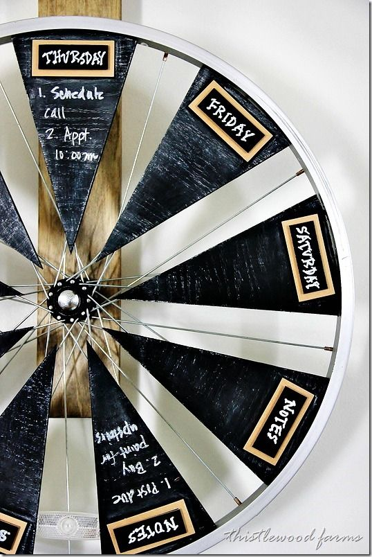 Hometalk :: Bicycle Wheel Calendar ~ weekly calendar from a bicycle wheel, plywood and chalkboard paint http://www.hometalk.com/3642978/bicycle-wheel-calendar?se=fol_new&tk=xfk7x3