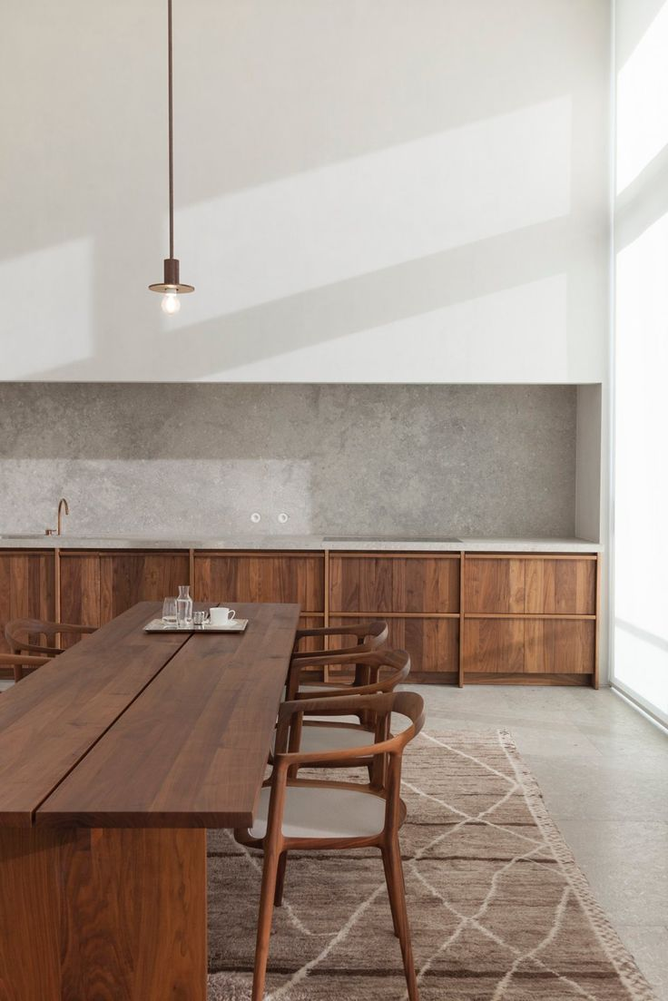 Quartzite kitchen and dining area with high ceiling. Penthouse S Westkaai Antwerp by Hans Verstuyft Architecten.