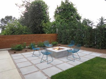 Get creative with concrete slabs. For this modern patio, large square slabs of concrete define the seating area surrounding an outdoor fireplace. When you are designing with concrete, you can also leave sections open for plantings, trees or other garden features, creating a custom look that suits your space perfectly.