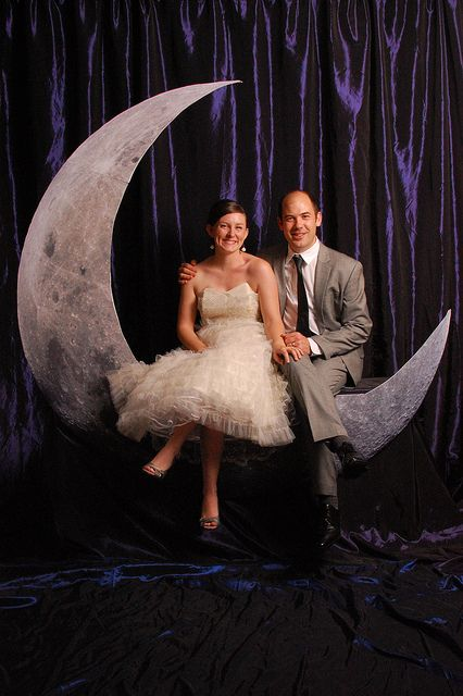 """With wood, foam board, some fabric, a high resolution picture of the moon, and a large scale printer, we constructed a Paper Moon-inspired photo booth for guests to enjoy during the reception."""
