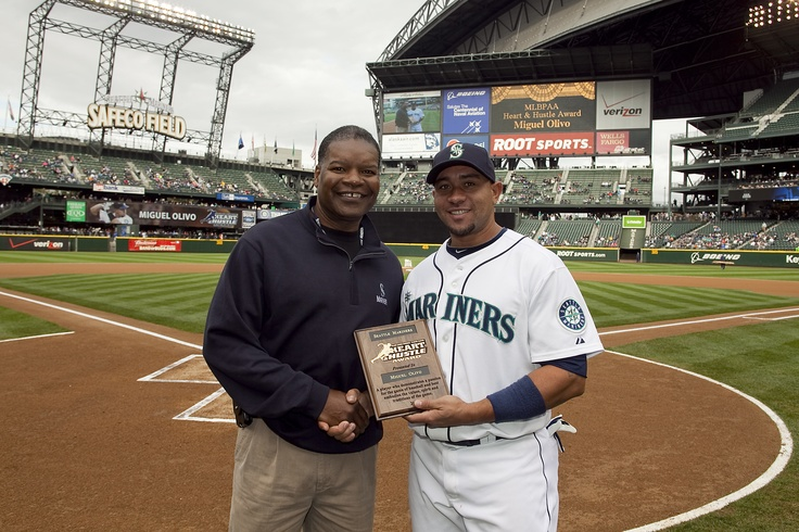 Dave Henderson presents the 2011 Seattle Mariners Heart and Hustle Award to Miguel Olivo at Safeco Field.