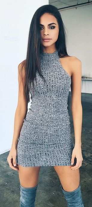 Knitted gray bodycone dress. High boots