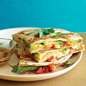 Kimchi and Avocado Quesadillas Recipe| Fusion at its finest! |  8 flour tortillas, 7 to 8 in. in diameter  1 jar (14 oz.) kimchi, drained and chopped  2 cups shredded jack cheese  2 avocados, thinly sliced $  1 tablespoon toasted sesame oil  2 tablespoons seasoned rice vinegar  1 teaspoon toasted sesame seeds  Cilantro leaves
