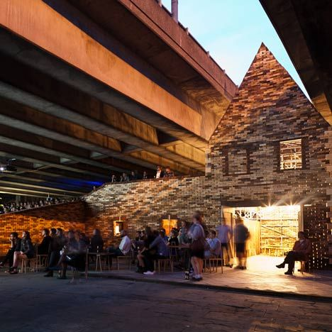 Folly for a Flyover   Assemble   2011   Non-profit organisation Assemble have constructed a temporary canal-side cinema under a London motorway flyover. Under the bridge lies an enclose cafe, bar and theatre seating for cinema productions. This was assembled by a team of volunteers over the course of a month using reclaimed and donated materials. More detail on dezeen.com