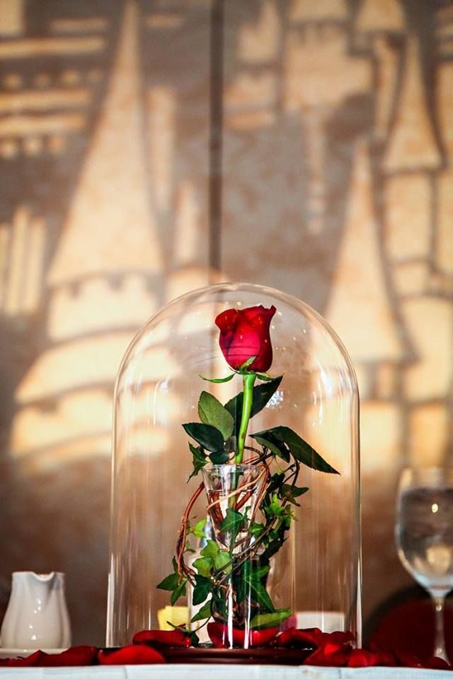 """wdisneyjr: """" This Beauty and the Beast inspired """"enchanted rose"""" centerpiece just may be one of our favorites! https://www.facebook.com/DisneyWeddings?fref=nf """""""