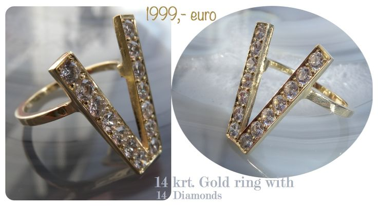 14 carat gold victory ring with diamond.