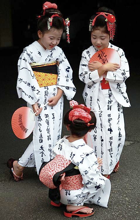 """""""This is another unique festival specially for """"topknot"""" or """"chignon"""". Once upon a time one lady in this region started using this special type hair style (seems to be normal for me), since then around 70 ladies including these girls make a procession with """"yukata""""(an informal cotton kimono for the summer season)in the city on 19 Sept of her birthday. Before start procession they are very busy for chat.""""  Photography and text  by Takero Kawabata on trek earth"""