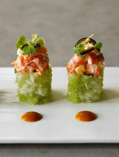 Wasabi Lobster Roll.  Shrimp, avocado, cucumber & carrot maki in wasabi tobiko with main lobster & mango salad, massago, cucumbers & soy pickled jalapeno. Mango mint chili sauce