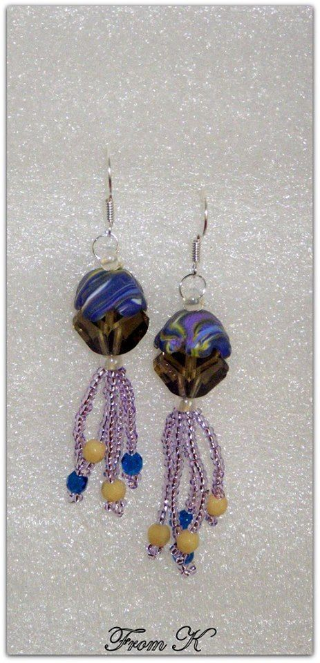 #Dangle #earrings. Czech crystals and seed beads are used as well as #polymer #clay hand marbled 8 petaled flowers fitted perfectly on top of the crystal. 4 cm long, 5 cm with ear wire. For more visit https://www.facebook.com/BeadsFromK/photos
