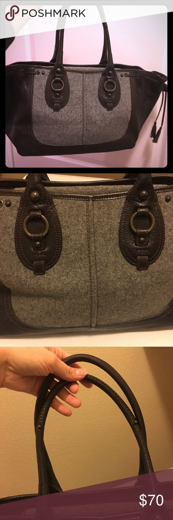 Banana republic felt and leather tote like new Banana republic felt and leather tote like new! Only a small scuff on the bottom shown in pictures Banana Republic Bags Totes