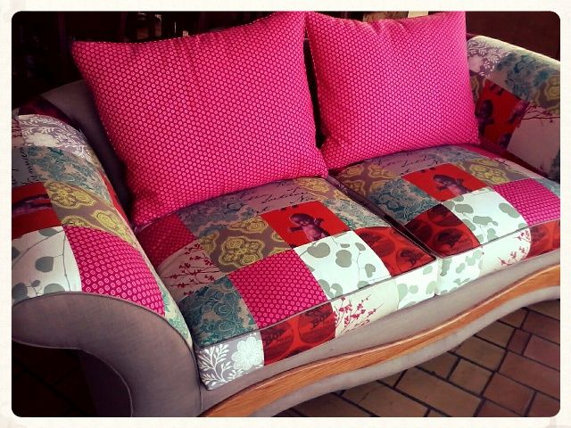 Two-seater couch: re-upholstered in clay and bright, colourful patches.