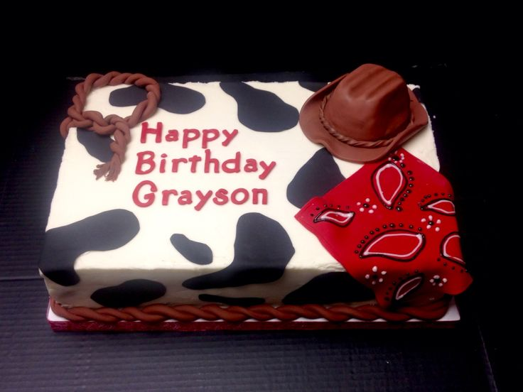Vanilla sheet cake with buttercream icing. Sugar sheet cow print with fondant cowboy hat, lasso, rope & royal icing piped bandanna.