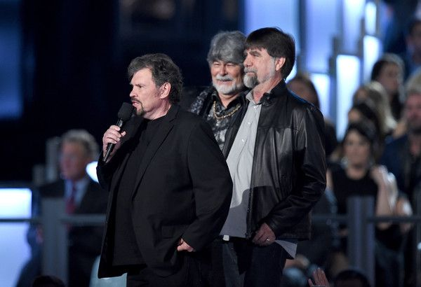 Randy Owen Photos Photos - Musicians Jeff Cook, Randy Owen and Teddy Gentry of Alabama speak onstage during the 50th Academy Of Country Music Awards at AT&T Stadium on April 19, 2015 in Arlington, Texas. - 50th Academy Of Country Music Awards - Show
