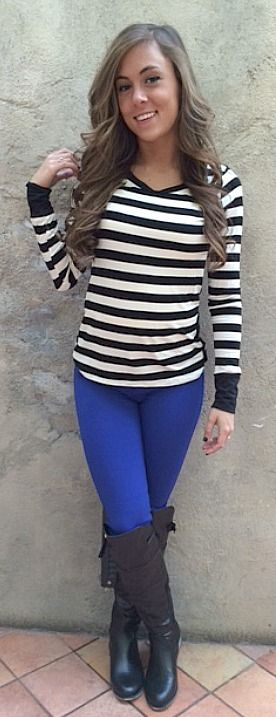 The perfect striped top paired with blue skinny pants and midnight boots.
