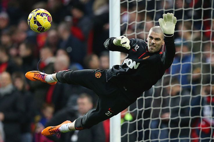 Victor Valdes of Manchester United takes part in the warm-up before the Barclays Premier League match between Manchester United and Southampton at Old Trafford