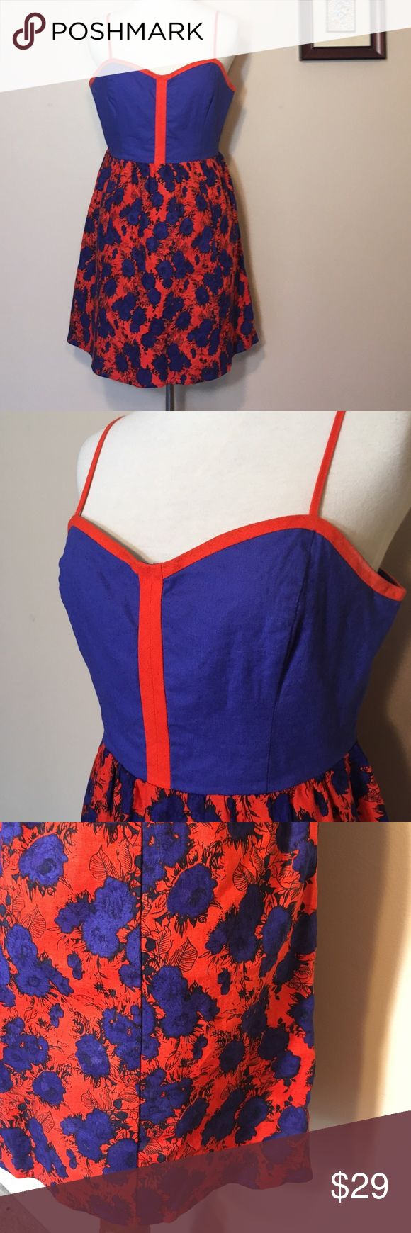 Urban Outfitters Cope Red Blue Floral Sundress M Gorgeous colorblock dress with a floral skirt. Has a snapped open back and spaghetti straps. The red is really vibrant and almost like an orange. Nice material and well made! Size medium. Urban Outfitters Dresses Mini