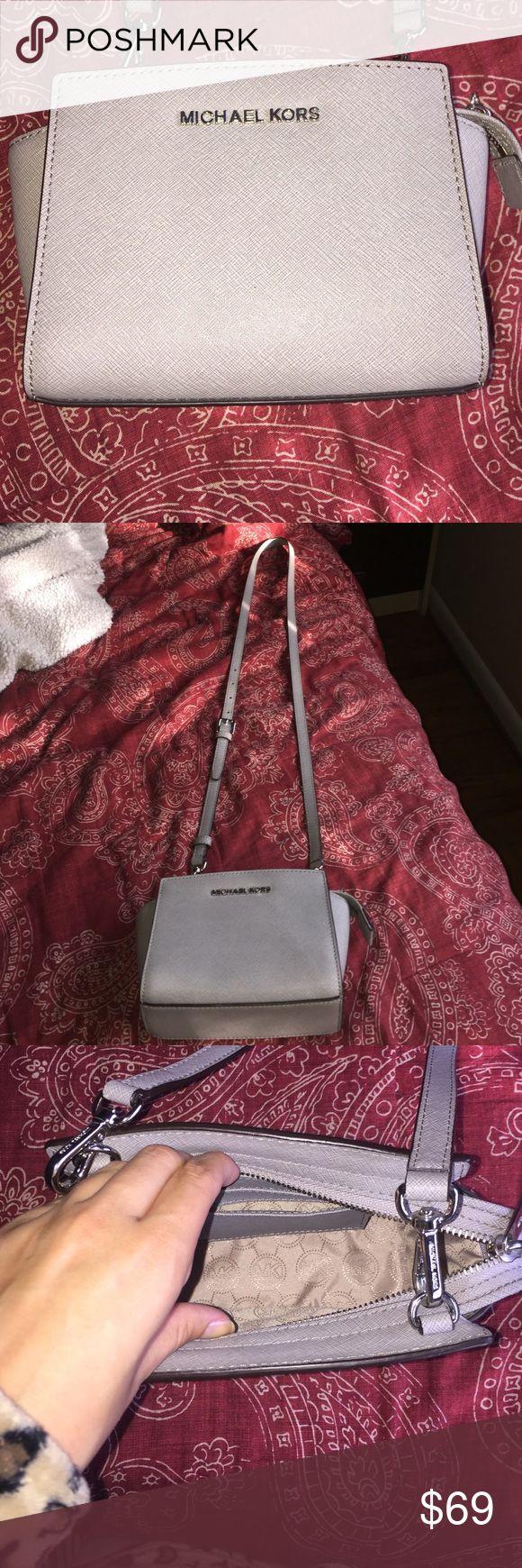 Michael kors grey pocketbook Never been worn, perfect condition michael kors pocketbook... adorable!!! Michael Kors Bags Crossbody Bags