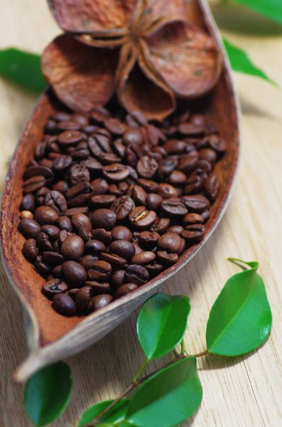 Put a candle in with the coffee beans for a wonderfully scented room