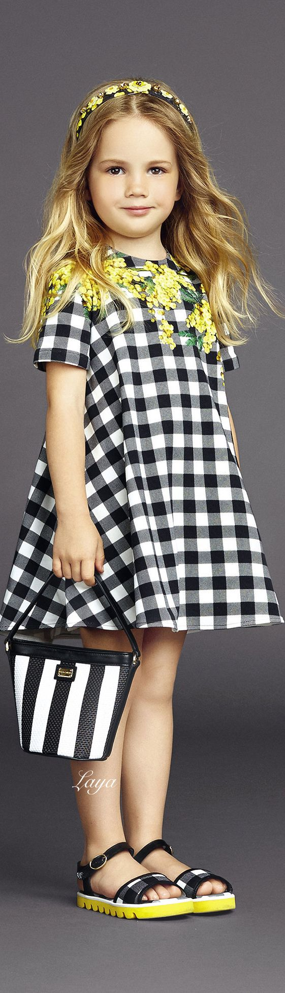 Adorable in black & white checks, she is ready to hit the birthday party in style.