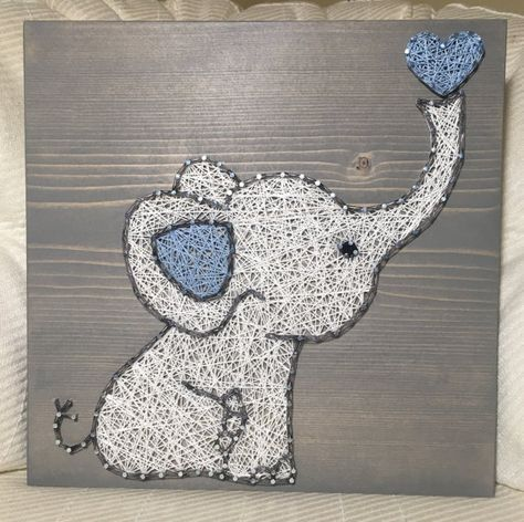 This adorable elephant would be a sweet addition to your babys nursery or childs bedroom! Or add it to your elephant collection! Please specify pink or blue in the notes! Size is 11 by 11. You choose the wood stain (gray, dark brown, light brown, or white) and string colors (elephant will be white unless you note otherwise). A sawtooth hanger is added to every board. Shipping overages will be refunded. Thank you for checking out my listing! You can find more at my Etsy shop- www.KiwiStrin...