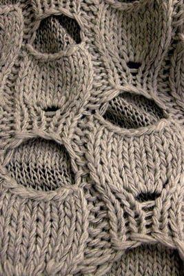 Vero Moda 2010 knitwear - using button holes for a punk aesthetic.