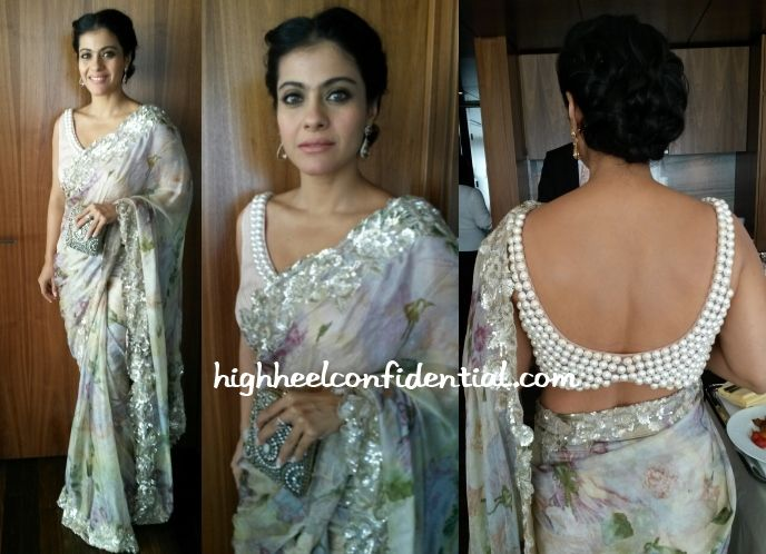 In NYC to promote Lifebuoy's handwashing campaign, Kajol attended the 4th Annual Official First Ladies Luncheon today wearing a floral Shehlaa sari. The more interesting part about this outfit was the oversized pearl trim on the blouse that extended all the way to the back. The blouse isn't something I would be drawn to but it looked nice on her.  A pair of Chopard earrings and a Malaga clutch finished out her luncheon look.  - See more at…