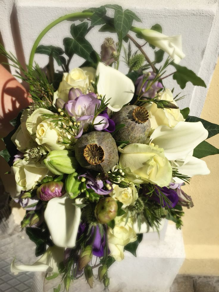 A asymmetric shape bride bouquet, a mix of purple and white shades flower, the order was different and beautiful.
