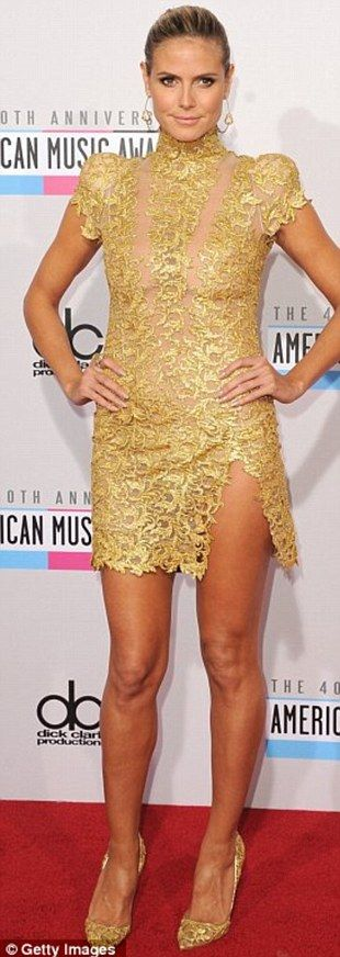 Heidi Klum modelled her golden lace dress to perfection at the 40th Anniversary American Music Awards