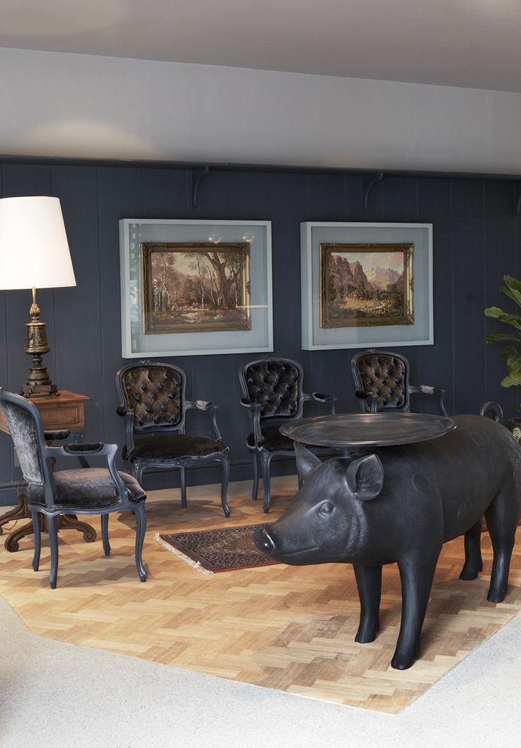 Boutique hotel | Reception | Wall panelling | Moooi | Pig table | Oil painting | Front Design | Herringbone floor | Etienne Hanekom Interiors