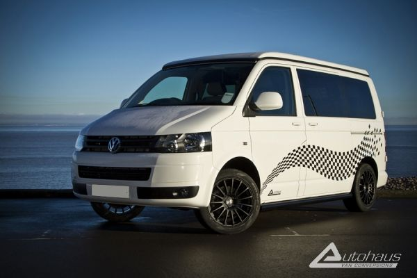 A stunning Candy White VW T5 Campervan with Checker Decals and a very beautiful Gloss Black interior!