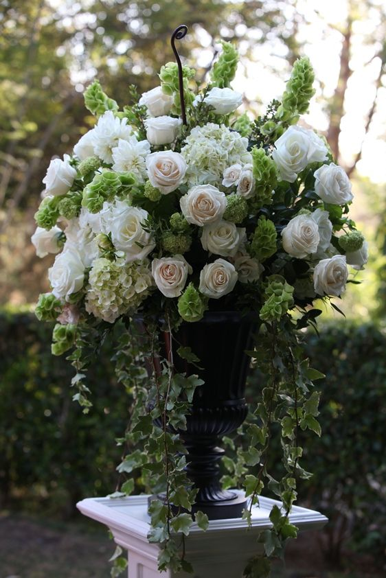 Urn Arrangement in Creams and Greens - Outdoor wedding setting