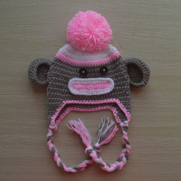 """This cute little sock monkey will be extra sweet on your little monkey! Hand crocheted with 100% soft cotton. Cozy warm and breathable - has a super soft fuzzy feel against baby's head. This is a """"REA"""