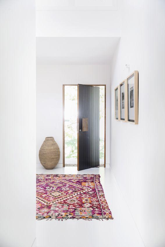 Pretty colorful rug + white walls (Tigmi Trading).