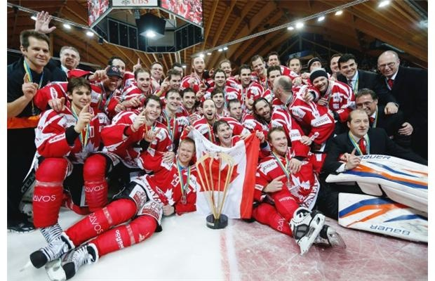 Team Canada celebrates with the winner's trophy after defeating HC Davos by a score of 7-2 in the final game of the 86th Spengler Cup ice hockey tournament on Dec. 31, 2012 in Davos, Switzerland.