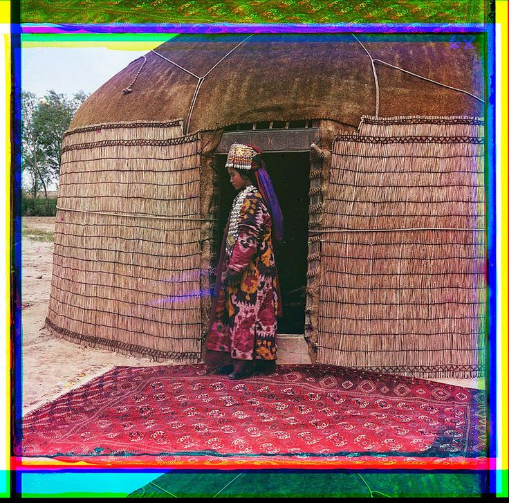 [Full-length profile portrait of a woman, possibly Turkman or Kirgiz, standing on a carpet at the entrance to a yurt, dressed in traditional clothing and jewelry] (LOC) | Flickr - Photo Sharing!