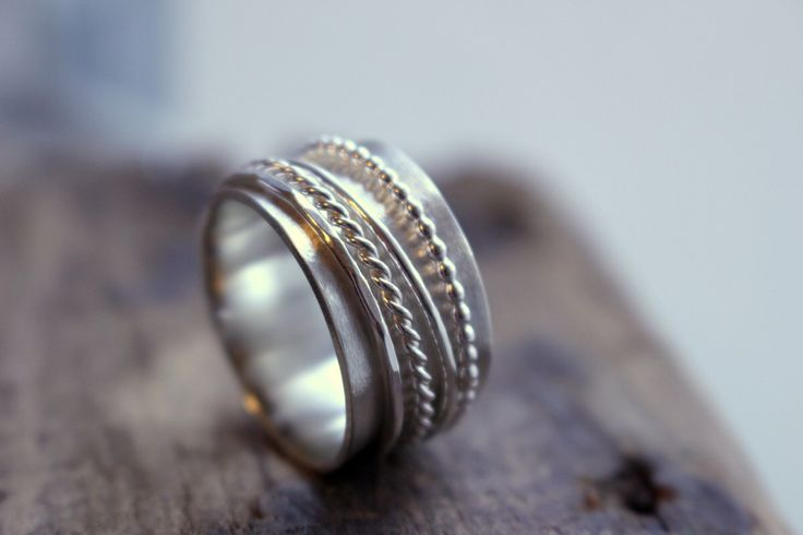 A personal favorite from my Etsy shop https://www.etsy.com/listing/515241407/sterling-silver-spinner-wide-band-ring