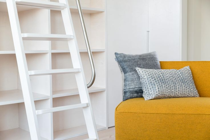 Rolling library ladder made from washed plywood designed by Studio Mills.