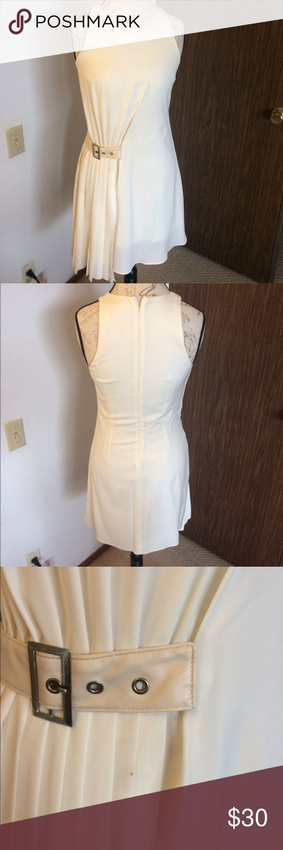 """Rehab brand off white mini SZ M Great condition, only worn once. Super comfy with conservative neckline. Right side pleat detail gives it a 20's style look. Lined lightly, pleat side does a bit longer so style. Small flaw in form of pin sized mark under belt (pictured in 3rd image) I'm guessing it was pen of some sort. Did 3 rounds of wine away and it got lighter each time so prob can get the rest out. Dry cleaned after worn immediately. 25"""" from armpit to bottom, lose fit and I'm a 4/6 at…"""