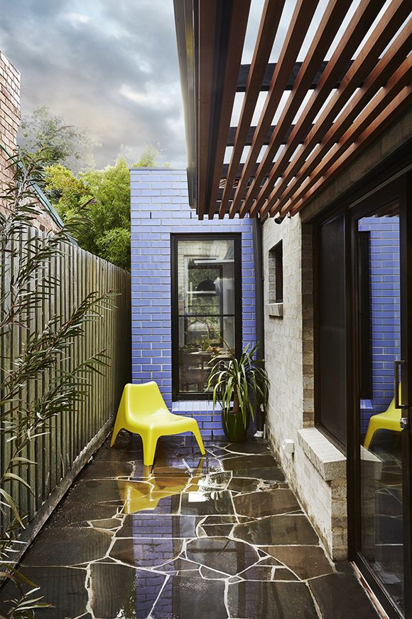 Euroa- Glazed Bricks in 'Violet' wrap the east façade of our addition in Northcote. New sliding timber doors connect the living room to a crazy-paved courtyard