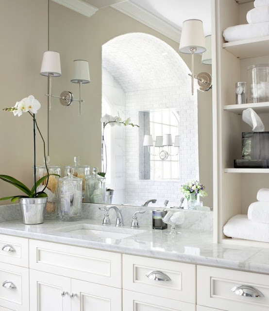 I like the big mirror and the sconces mounted directly it.